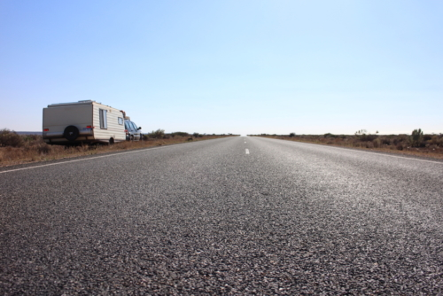 The road and our caravan.Travelling Family Australia